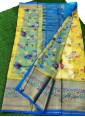 Perfect Yellow and Blue Organza Saree in allover Flower Design with Kanchi Border - 1