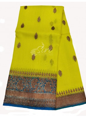 Appealing Neon Yellow Banarasi Kora Handloom Silk Saree in Allover antique Buti Design