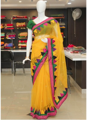 Beauteous Yellow Banarasi Net Saree in Multi Colour Temple Border
