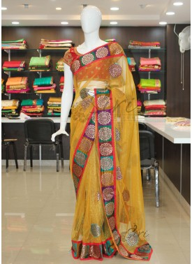 Beautiful Yellow Shimmer Net Saree Teamed with Pur