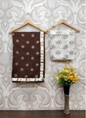 Brown Jute Saree in Foil Print Teamed with Fancy Borders
