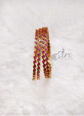 Elegant Set of Four Bangles in Rubies