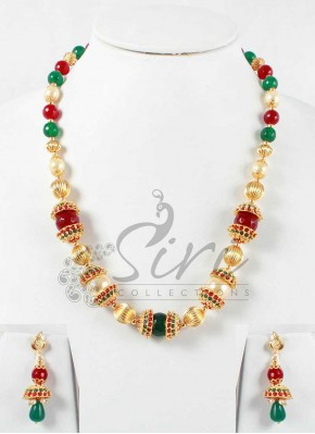 Gold balls and pearls, red and green onyx maala in caps