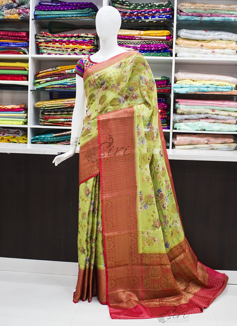Green and Red Organza Saree in allover Flower Design with Kanchi Border