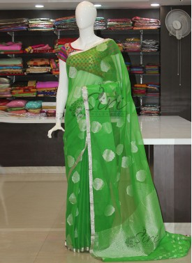 Green Banarasi Net Saree in Rich Silver Zari Butis and Border