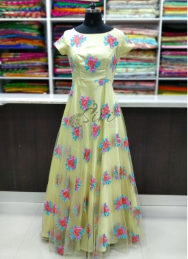 Lovely Baby Yellow Long Frock in Multi Colour Embroidery Work