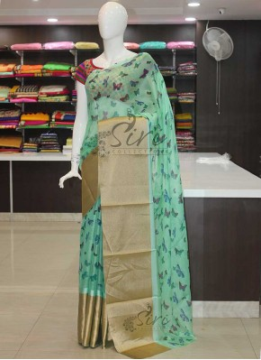 Lovely Digital Print Shimmer Jute Silk Saree in Gold Border