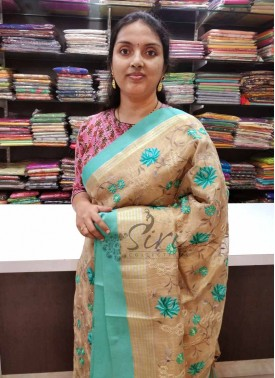 Lovely Gold Soft Tissue Saree in Heavy Embroidery Work