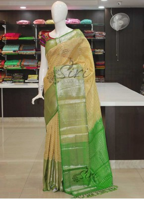 Offwhite cream Green Kuppadam Silk Saree in Silver Zari