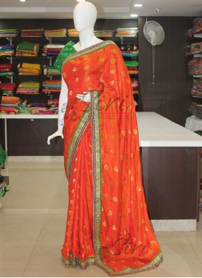 Orange Jacquard Crepe Designer Saree with heavy Stone Work Borders
