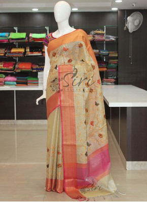 Pale Yellow Tissue Saree in Rich Kanchi Borders and Embroidery Work