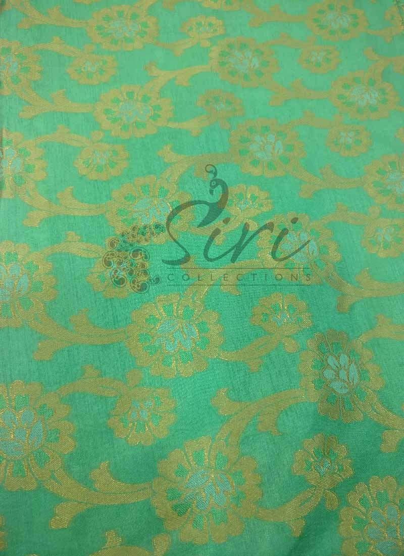 Pastel Green Blue Fancy Silk Fabric in Self Design Per Meter