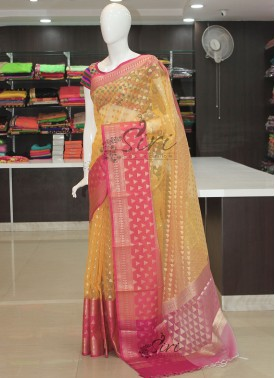 Pastel Yellow Organza Saree in Rich Borders
