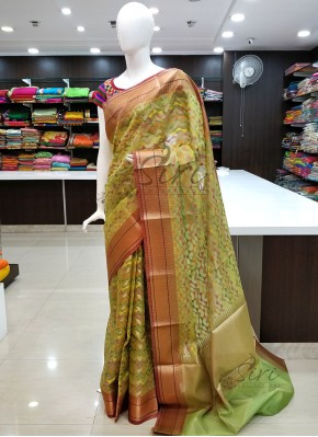 Pista Green Designer Saree in Multi Colour Geometric Weave