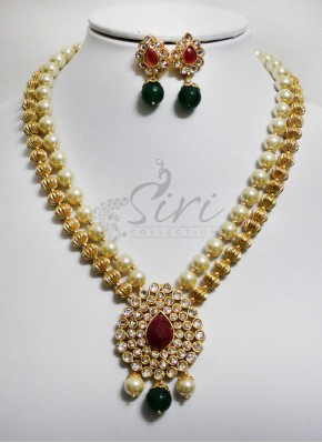 Polki necklace set in gold balls and pearls