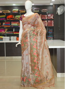 Pretty Pastel Peach Tissue Saree in Embroidery Work