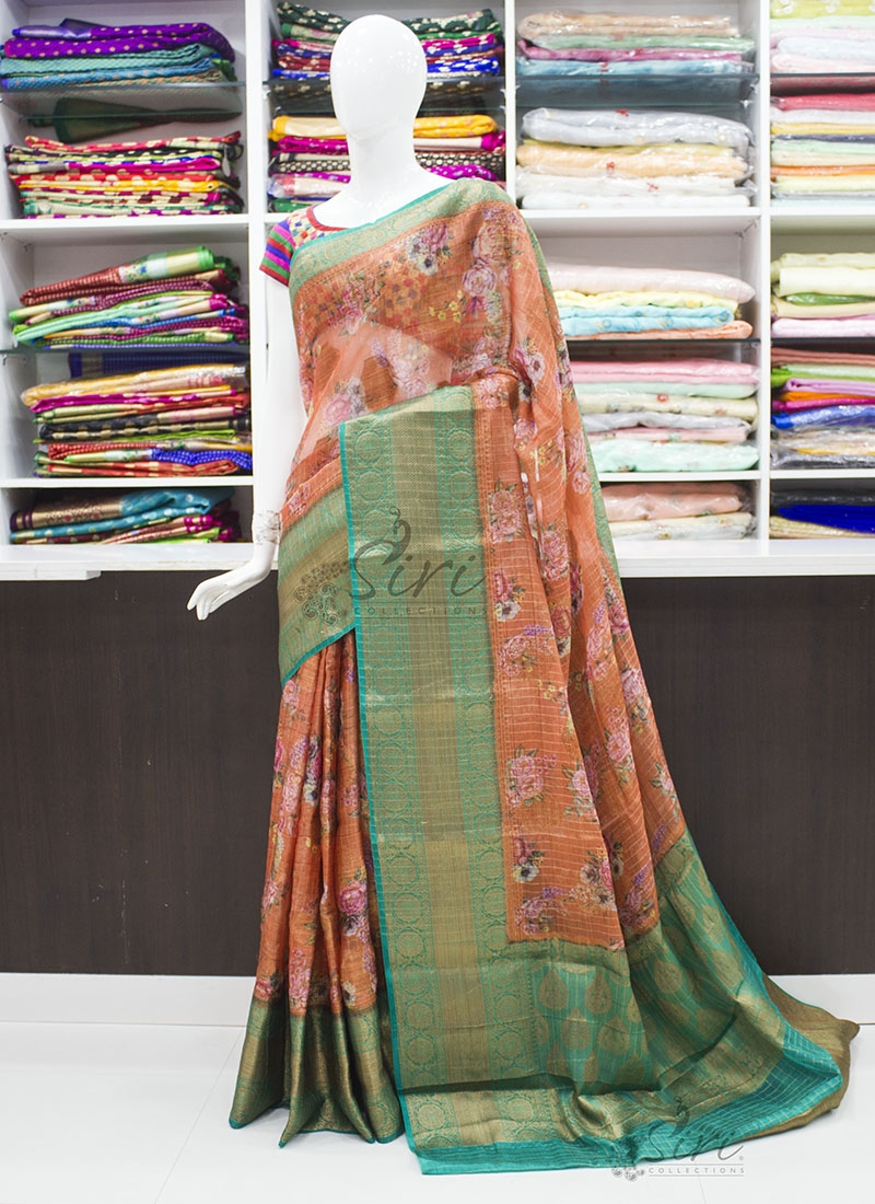 Rust and Rama Green Organza Saree in allover Flower Design with Kanchi Border