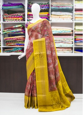 Rust and Yellow Organza Saree in allover Flower De