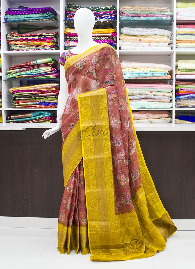Rust and Yellow Organza Saree in allover Flower Design with Kanchi Border