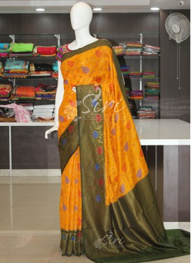 Yellow Dark Green Dupion Silk Saree in Antique Zari