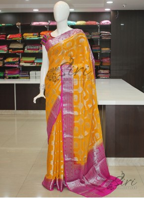 Yellow Magenta Pink Fancy Banarasi Georgette Saree in Silver Zari